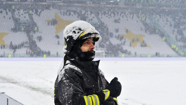 A firefighter watches the pitch of the Allianz Stadium in Turin, Italy
