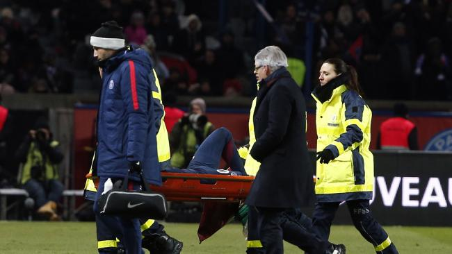 PSG's Neymar leaves the pitch on a stretcher after being injured