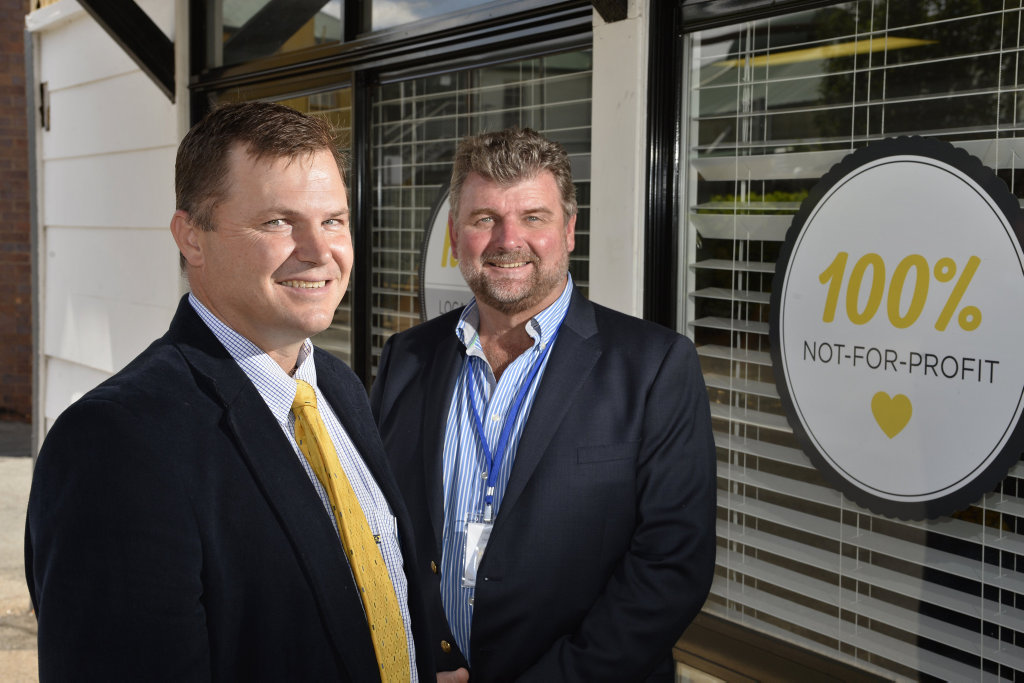 Toowoomba Masonic Council secretary Craig Reimers (left) and Hand Heart Pocket CEO Gary Mark discuss the freemasons charity donatation to YellowBridge Queensland to build a three-bedroom supported living unit in Toowoomba, Monday, February 26, 2018.