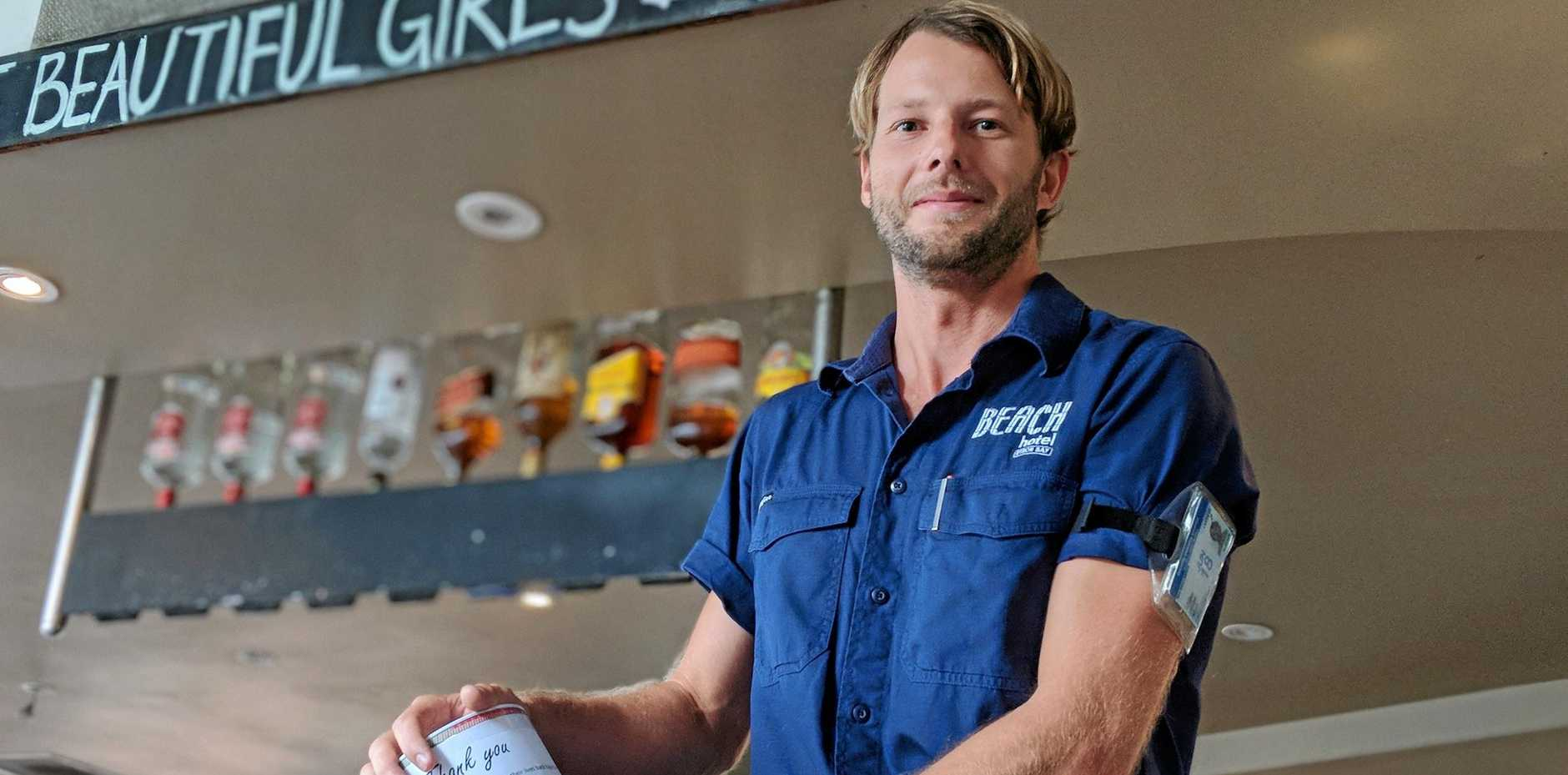 POKIE FREE: Beach Hotel manager Marc Labonte encourages donations to The Buttery, as part of the hotel's event to celebrate going Pokies Free on the weekend.
