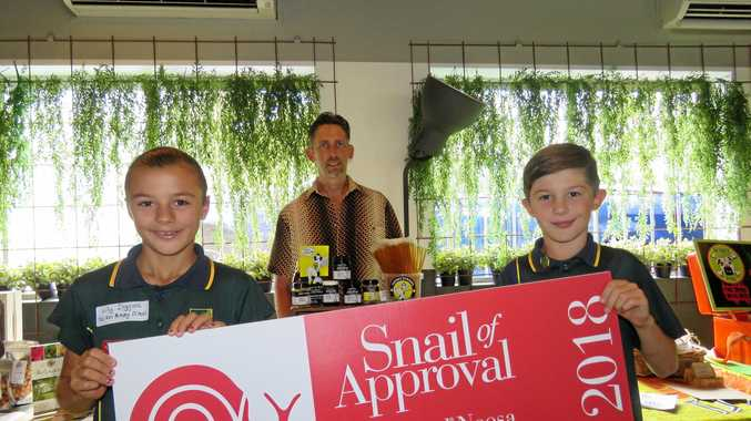 Kin Kin State School pupils Lilly Diggins and Fynn Uechtritz hols the Snail of Approval award at Padstow's, with garden manager Keith Gilbert looking on.