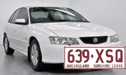 The missing girls may be travelling with two men in a white 2003 Holden Commodore with QLD registration 639XSQ (similar to the one pictured).