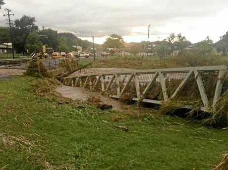 Roads have been damaged and a foot bridge has been swept away after more than 150mm fell in Springusre this morning.