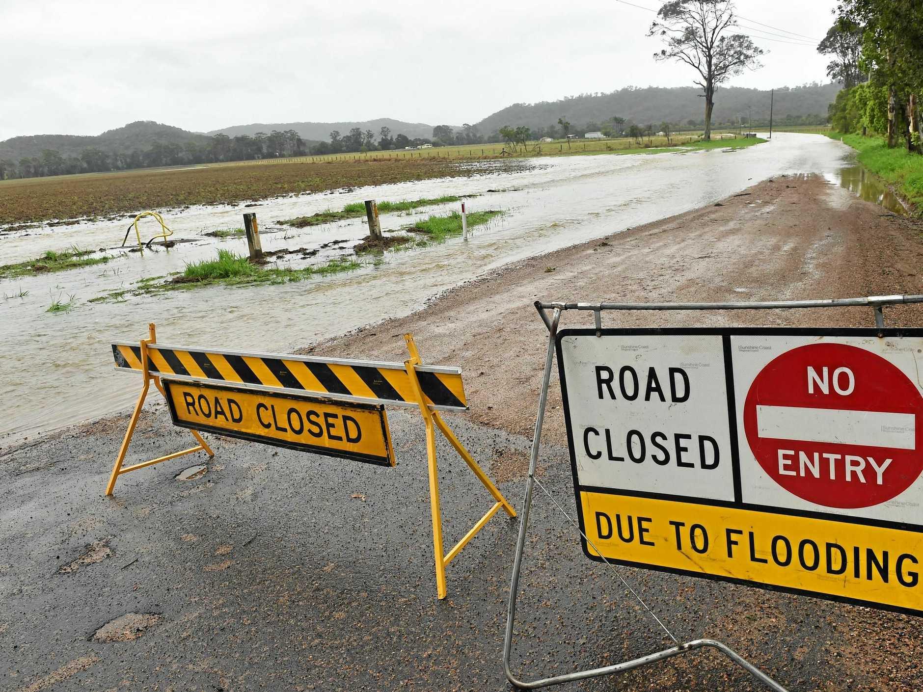 Motorist risks floodwaters at North Arm-Yandina Creek, East of Targoo Road.