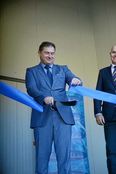 Member for Wide Bay, Llew O'Brien cuts the ribbon to open the Nolan Meats state of the art processing plant last year.