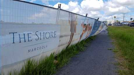 Residents have raised concerns about a fence that has repeatedly fallen over at The Shore development site in Marcoola.