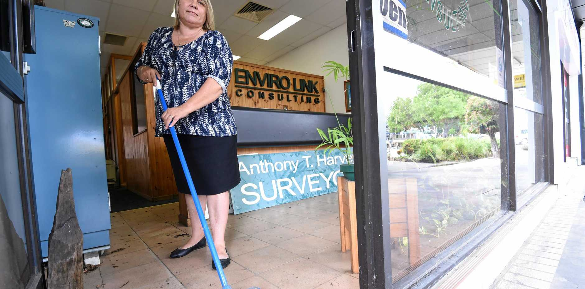 Envirolink Consulting manager Leanne Bedwell cleans out the store in Casino after a flash flood on Monday.