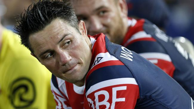 Cooper Cronk sits on the bench during a Roosters trial.