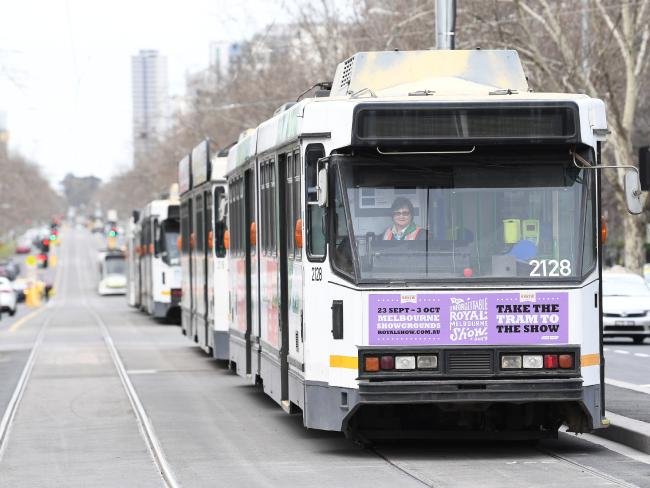 City commuting should prioritise road space to public transport vehicles such as trams and buses, according to the report. Picture: AAP Image/James Ross