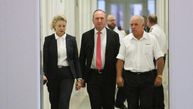 Barnaby Joyce flanked by Bridget McKenzie and John 'Whacka' Williams as he walks to the National's party room meeting in Parliament House yesterday. Picture: Gary Ramage