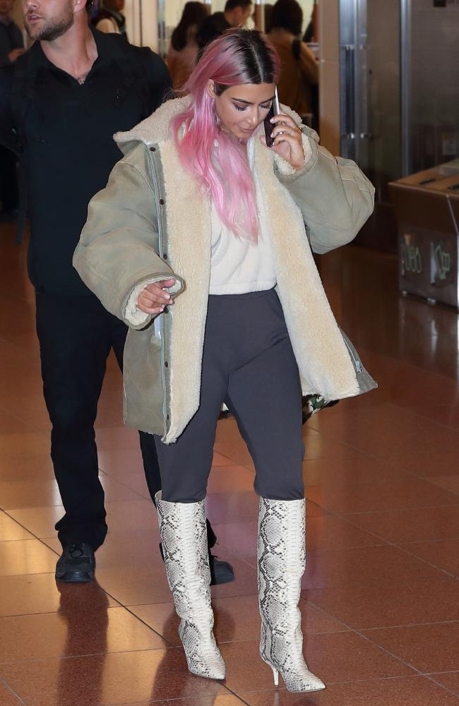 Pink lady! Kim Kardashian showed off her new bubblegum 'do at Haneda International Airport. Picture: Splash