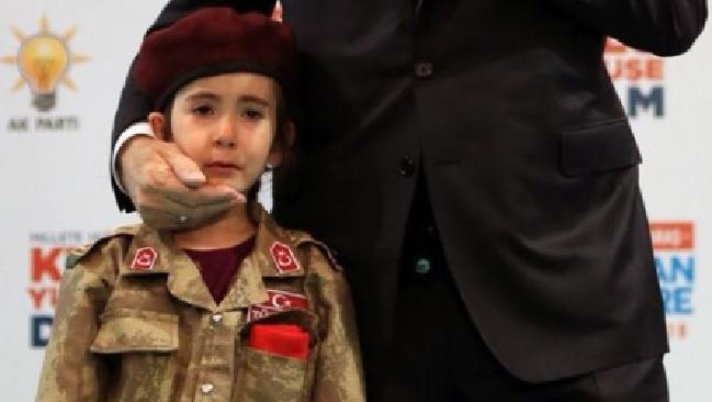 Six-year-old Amine Tiras was in tears when Turkish President Recep Tayyip Erdogan summoned her from the audience onto a stage at a rally. Picture: YouTube.