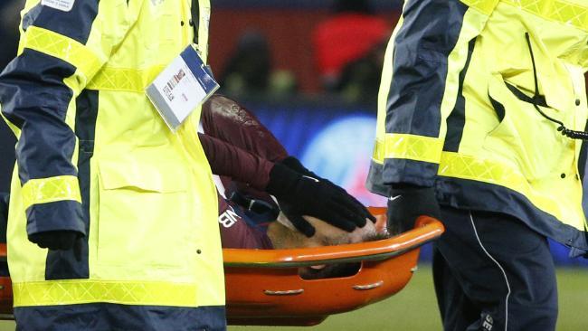 Paris Saint-Germain's Brazilian forward Neymar Jr is carried off on a stretcher
