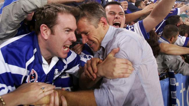 Premiership winning Bulldogs coach Steve Folkes is swamped by fans.