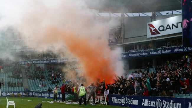 Wanderers fans light a flare during the Sydney FC v Western Sydney Wanderers A-League match at Allianz Stadium. Picture: Brett Costello