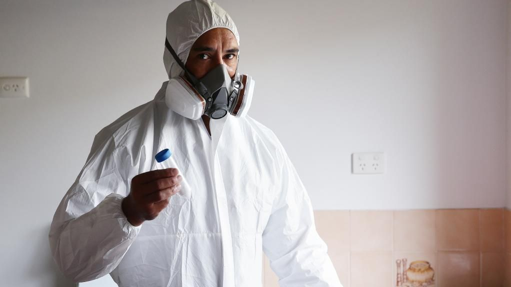 Dion Te Maru at a vacant rental property in Redland Bay. He is a technician with Smoke Alarm Solutions/Meth Screen. Picture: AAP/Claudia Baxter