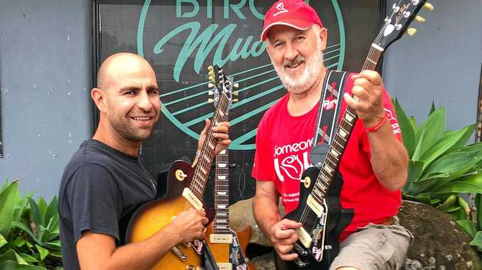 GUITARS: Owner of Byron Music Nick Sergi with CF Australia's Alan Tunks and the three Gibson Les Pauls being raffled this year.