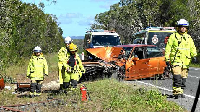 CRASH: Crashes like the one above on Tin Can Bay Rd last year are all too common according to road safety advocate Wayne Scahs (inset) iwho is pushing for compulsory driver eduction in all Queensland high schools.