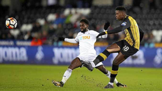 Swansea City's Nathan Dyer, left and Sheffield Wednesday's Lucas Joao battle for the ball.