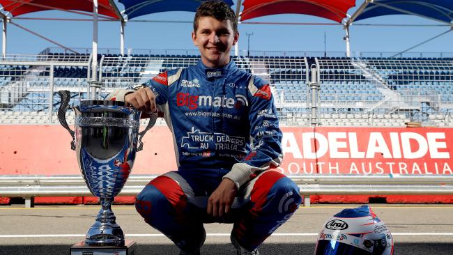 27/02/18 South Australian Supercars rookie Todd Hazelwood unveils the New Adelaide 500 Trophy in pit straight. picture CALUM ROBERTSON