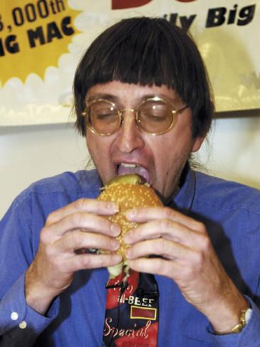 Don Gorske biting into the 18,000th Big Mac in 2001.