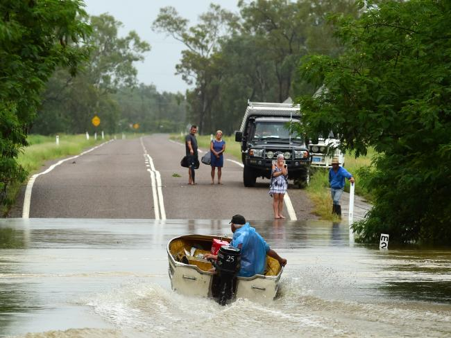 Poultry farmer Jeff Ironside heads back for more after bringing people across the Bohle River near Townsville after roads were cut by flood waters. Picture: Evan Morgan