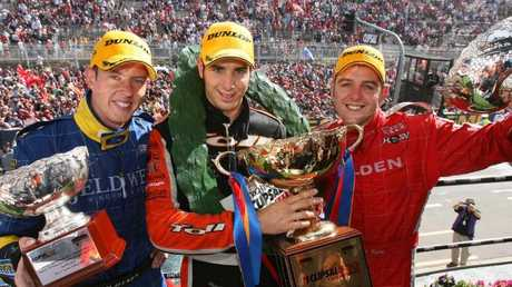 Winner Rick Kelly, middle, with runner up Todd Kelly, right and third-placegetter James Courtney, left, on the podium after the 2007 race. Picture: Mark Horsburgh, Edge Photography