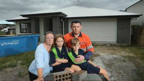 Martin Sorrell, wife Kristi Sorrell and children, Sasha 8 and Marcus 7, in front of their partially built home at Ormeau Hills. Kristi and her family were building with Future Urban Residential, which is now unlicensed and their home is unfinished. Picture: Glenn Hampson
