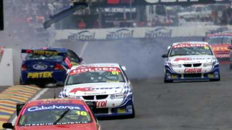 Marcos Ambrose spins out in pit straight in 2001.