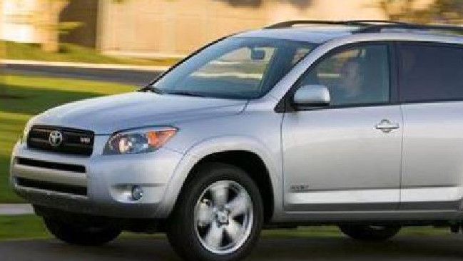 The woman was driving a  silver SUV similar in size to a Toyota Rav 4.
