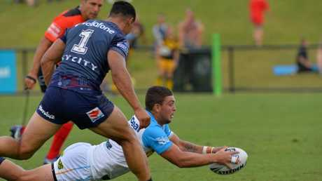 Ash Taylor scores for the Gold Coast Titans in their NRL pre-season trial against the New Zealand Warriors at Sunshine Coast Stadium. Picture: Patrick Woods