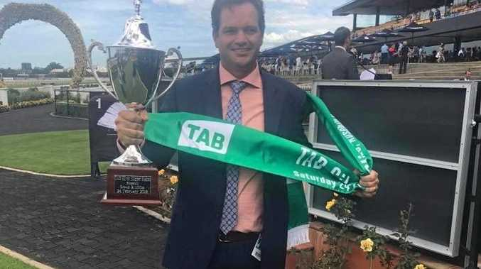 TROPHY: Dan Fletcher in the winner's circle at Rosehill last Saturday after Sunlight's big win.