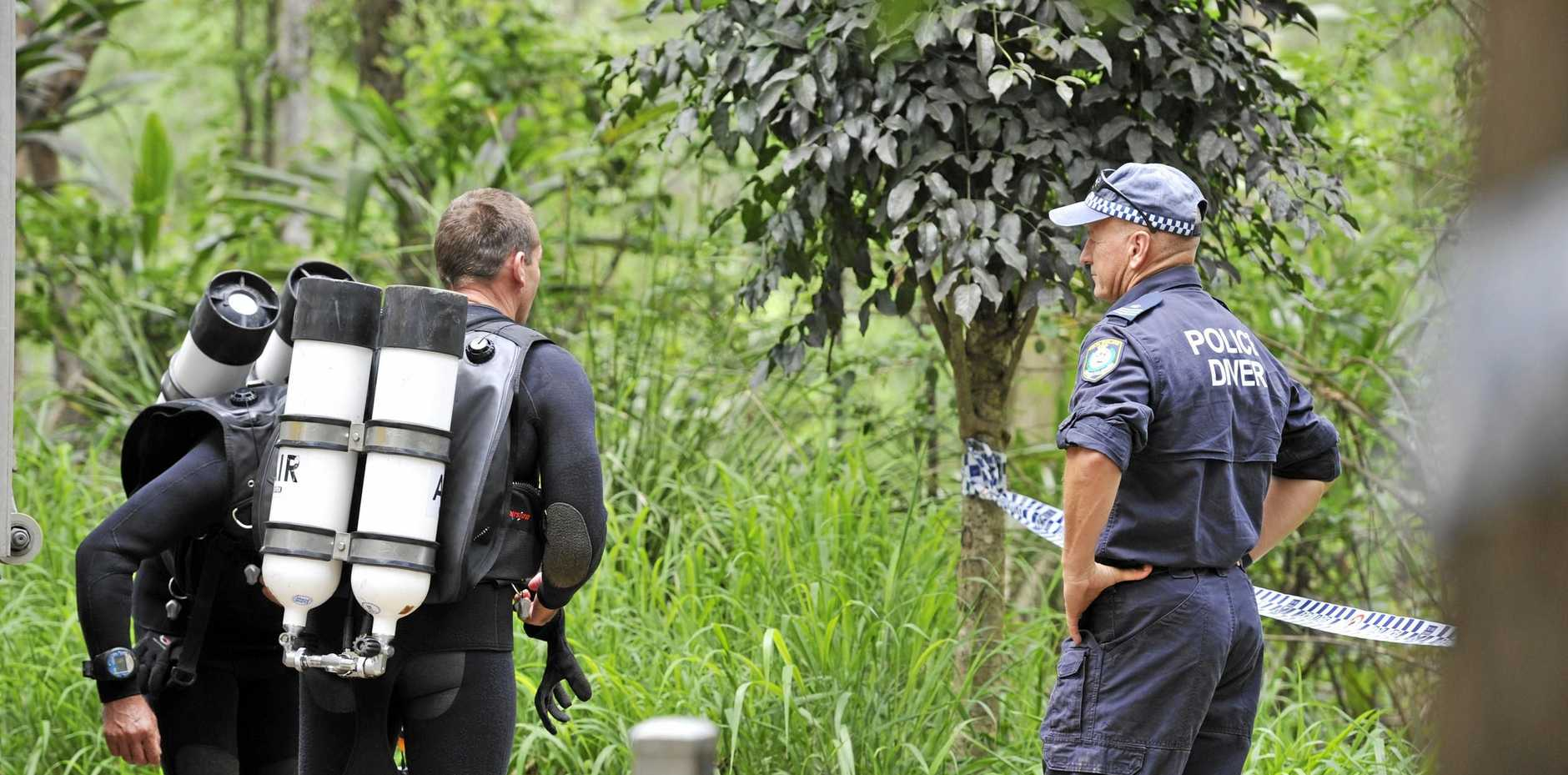 Police divers attend the scene at Hanging Rock Falls waterhole where a man went missing. Photo Marc Stapelberg / The Northern Star