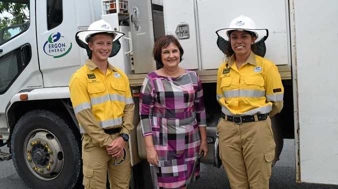Member for Mackay Julieanne Gilbert congratulates Ergon apprentices Sean Dalton (left) and Leah Deveraux.