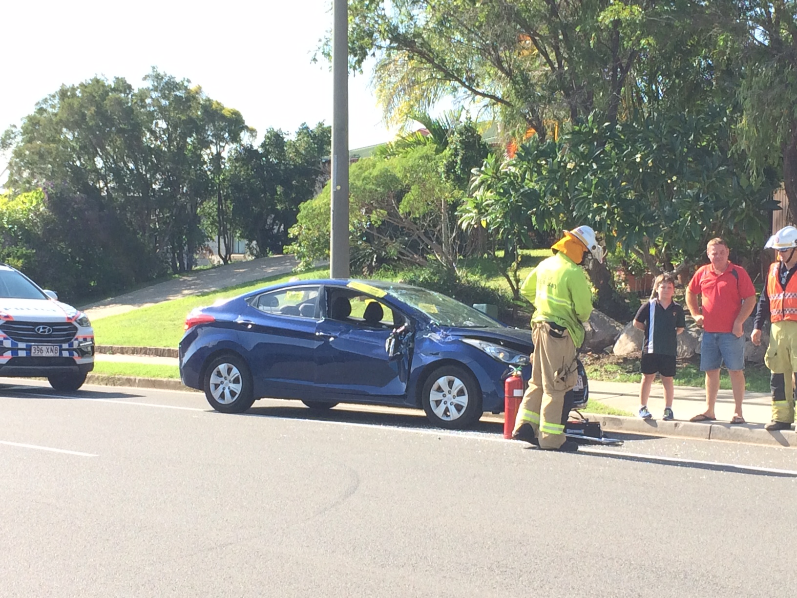 Paramedics are assessing one patient after a blue Hyundai was T-boned by another car in a two-vehicle crash.