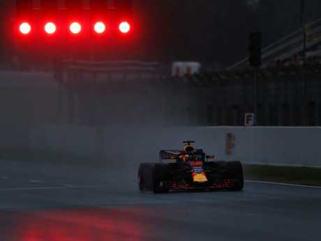 Daniel Ricciardo drives his Red Bull in a snowy testing session.