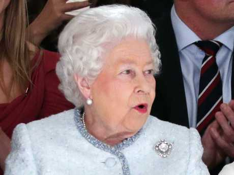 Britain's Queen Elizabeth II reacts at London Fashion Week. Picture: AFP