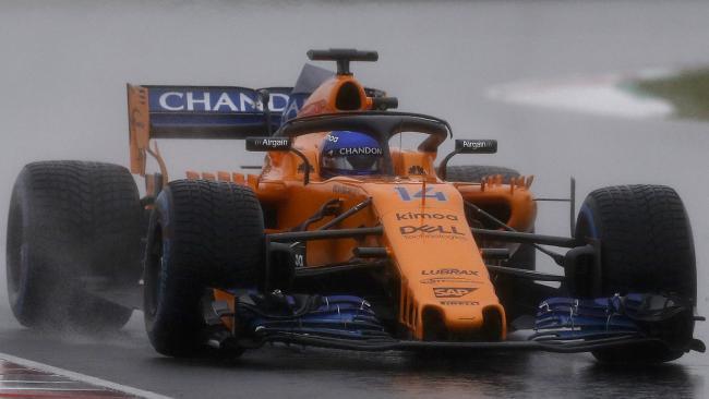 Fernando Alonso tests the McLaren in the rain.