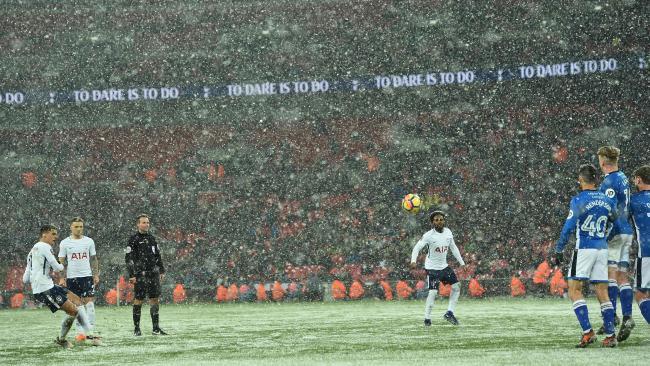 Tottenham Hotspur's Argentinian midfielder Erik Lamela (L) takes a free kick