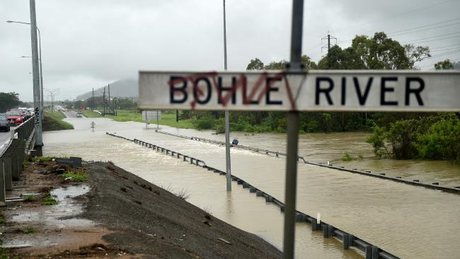 Flooding across Townsville. Lower Bridge closed on the Bohle River as overflow covers the road. Picture: Alix Sweeney