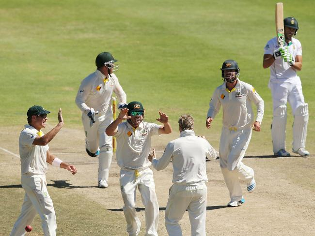Australian players celebrate after Steve Smith dismisses Faf du Plessis.