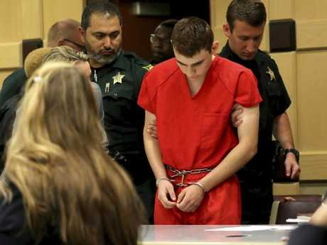 Nikolas Cruz appears in court for a status hearing before Broward Circuit Judge Elizabeth Scherer, facing 17 charges of premeditated murder. Picture: AP/Mike Stocker/South Florida Sun-Sentinel