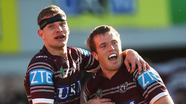 Manly's Tom Trbojevic celebrates with brother Jake Trbojevic. Picture. Phil Hillyard