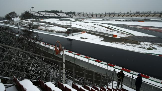 The Catalunya racetrack, with snow-covered infield and seating.