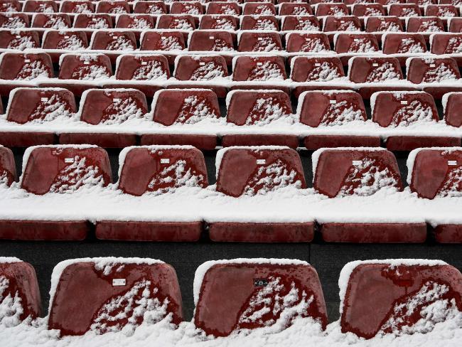 Snow covers tribune seats after a snowfall at the Circuit de Catalunya.