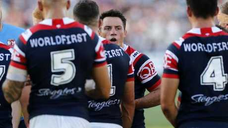 Cooper Cronk of the Roosters talks to the team.