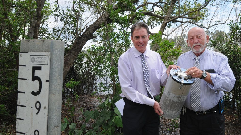 Fraser Coast mayor Cr Gerard O'Connell and Disaster Planning co-ordinator Mal Churchill with the canister that is a part of the weather station called an Alert Monitor. Photo: Robyne Cuerel / Fraser Coast Chronicle