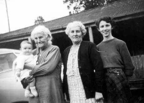 Four generations of Burgess women at Bankfoot House, Glass House Mountains, ca 1952. Clementina Burgess (nee Grigor) is holding her first great grandchild. Clementina (1878-1963) was born at Bankfoot House, where she lived her entire life.