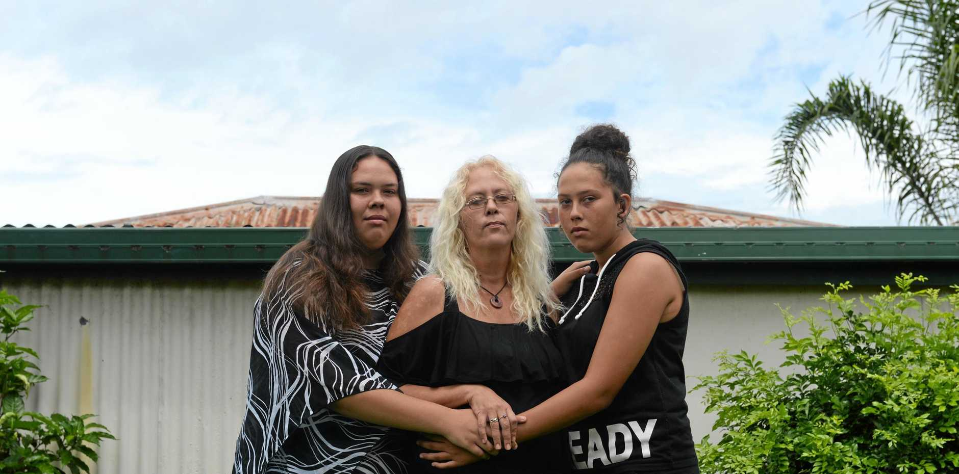 Julia Cavanagh, mum Jodi Craig, and younger sister Jayda Cavanagh in the backyard of their home.