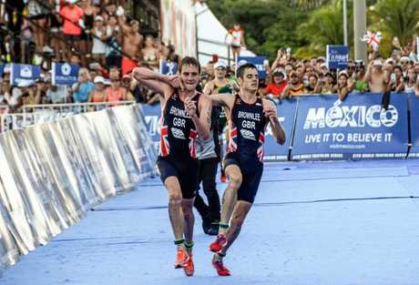 The famous scene where Alistair Brownlee (left) helped his energy depleted brother Jonathan Brownlee before crossing the line in second and third place during the ITU World Triathlon Championships 2016 in Cozumel, Mexico.